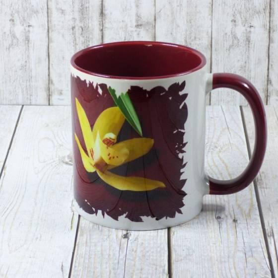 Kaffeetasse mit Blumen (Cymbidium Orchidee als Blumenmuster)