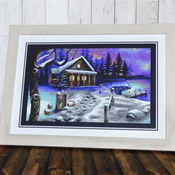 Schönes Winter-Motiv in C-64 Pixel-Optik im Holzoptik-Rahmen ca. 30x21cm